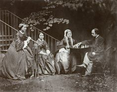 Dante Gabriel Rossetti with his family, playing chess (1863) (later photogravure)  Photographer: Charles Dodgson (a.k.a. Lewis Carroll), England