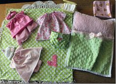 doll sleeping bag, blankie, diapers, wipes, clothes, etc