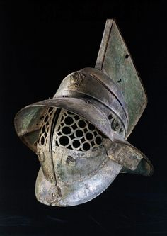 """lucienballard: """" Bronze Gladiator's helmet. """" Roman 1st Century. Height: 48.26 centimetres Said to have been found in the gladiators' barracks at Pompeii. It has a grille of linked circles to protect..."""