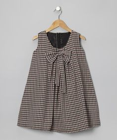 Charming gingham and a bow at the front have this piece singing with sweetness. Thanks to a half-zipper in back, a little darling will spend more time playing and less time getting dressed.