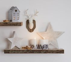 Cinnamon and orange scented candles will bring that festive feel to your home together with some star and stag accessories