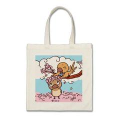 Finches birds with pink sakura flowers canvas bags. Cute bird drawing with sakura flowers gifts #birdthemedgifts #giftsforbirdlovers #valentinegifts #valentineday #loveromance #girlypink #fallinginlove #inlovewithyou #iloveyou #birdcomic #happyanniversary #valentinehearts #finchlovers #pinkflowerwreath #petopet #emmilthomas #finchtotebag