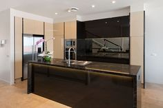 An elegant kitchen, designed and built by John Perini in a lovely beachside home in Albert Park. This kitchen uses Caesarstone's Vanilla Noir stone.