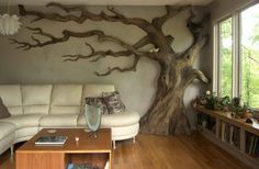 Sculpture/carving of a tree, from a tree, in a house.
