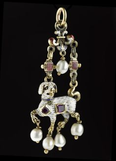 Pendant of gold in the form of a dog, enamelled and set with rubies and pearls: German, 16th century