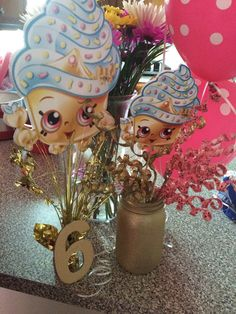 My daughters SHOPKINS centerpiece....gold and pink