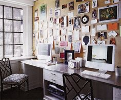 Love the chairs, love the cork board of ever-changeable art.