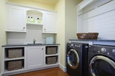 laundry-room-with-white-cabinets-and-baskets.jpg 600×397 pixels