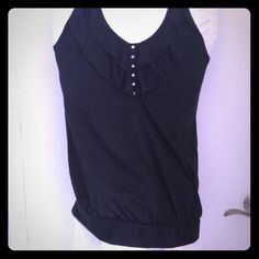 New with tags black embellished tank New with tags Grane black top.  -Understated ruffles in front -Beaded snaps -Racerback -Size L  Wear it casually during the day or dress it up with dark jeans for a night out! Grane Tops Tank Tops