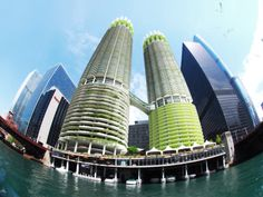 paris-based architecture office influx_studio : 'algae green loop',  a design proposal for an algae retrofitting of the marina city towers in chicago, illinois, USA.  utilizing the natural CO2 absorbing capabilities of the live material, the project explores ways  of urban decarbonization by integrating loops of bioreactors on to the 20th-century towers.