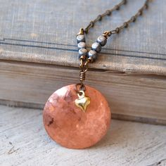 Copper disc necklace /heart charm necklace /modern pendant /rose gold necklace layering necklace. Tiedupmemories by tiedupmemories on Etsy https://www.etsy.com/listing/495846853/copper-disc-necklace-heart-charm