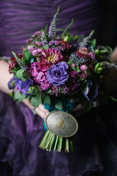 July bridal bouquet with grandfather's belt buckle on the stems