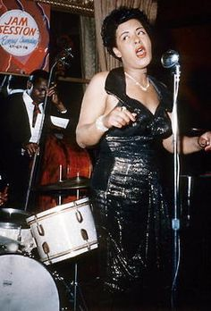 Billie Holiday on stage during a jam session in March 1954. Photo: Apic/Getty Images.
