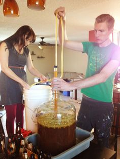 Brittany and Jackson Wilcox Bottling Home Brew IPA!  Delicious!