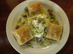 Baklava with whipped cream and pistachios