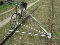 Bicycle on the tracks  Google Image Result for http://www.doobybrain.com/wp-content/uploads/2012/05/bicycle-on-the-train-tracks.jpg
