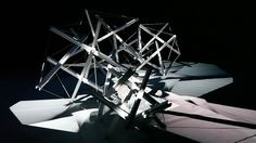 Ecdysis is an immersive audio-visual installation depicting biological and architectural adaptation. In Ecdysis, kinetic light, scored by ambient sound, is cast on 36 interwoven planes, suspended in space by their tensional integrity.