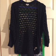 Justice cardigan Black cardigan with open holes. It's a size 16 in kids which is equivalent to a medium in adults as in American eagle. Justice Shirts & Tops