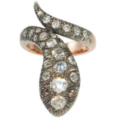 Diamond Serpent Ring. 18K rose gold over silver serpent ring set with 27 round European cut diamonds weighing about 4.50 carats total. c 1890