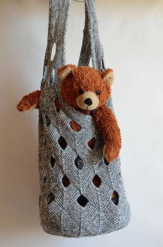 "Knitting pattern for Net Duffle Bag tote - Vivian Høxbro's Net Duffle Bag has a sturdy mesh-like texture formed by joining incomplete mitered squares. 28-1⁄4"" circumference and 21-1⁄4"" long, with 2"" edging at top"