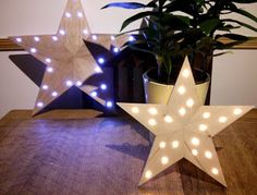 The shed and beyond.: Wooden star christmas decorations.