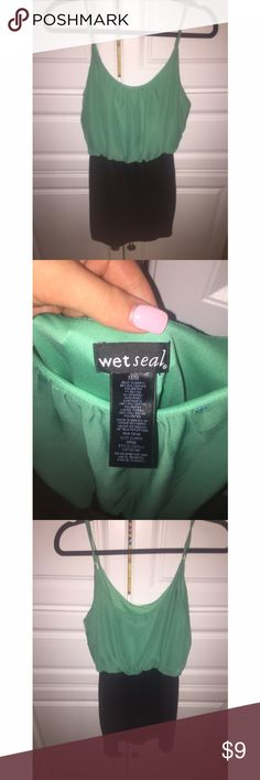 NWOT Wet Seal Party Dress ◾️Size: Medium ◾️Small string at neckline  ◾️Brand: Wet Seal ◾️Worn: Never ◾️ Manufacturing Country: Mexico of Imported Goods ◾️ Made of: 89% Polyester, 7% Rayon and 4% Spandex. Lining 100% Polyester ◾️No trades but all offers considered  ◾️Feel free to ask any questions💕 ◾️Ships out same or next day Wet Seal Dresses