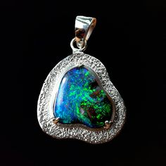 Stippled Seaside Pendant  This pendant tells the story of the meeting of two worlds - hot and steamy rainforest silver of Borneo meeting opal from the dry and dusty land of the Australian outback. Joined together these two bring forth a mystical beautiful pieces which captures the eye from every angle.