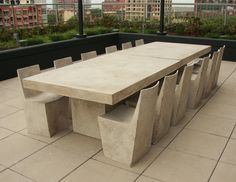 The design for this handcrafted dining table was conceived by working with the terrazzo-like technique of mixing stone aggregate with a malleable substrate. This aggregate and fiberglass table appears