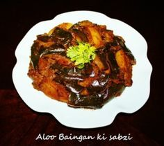 Aloo banigan is an amazing combination and make a delicious flavorful side dish when they cooked together with onion, tomatoes and spices. The Aloo Baingan preparation of Potato and eggplant is thick in consistency so it is easy to pack with paratha for l Seafood Recipes, Indian Food Recipes, Vegetarian Recipes, Cooking Recipes, Seafood Meals, Eggplant Curry, Sabzi Recipe, Vegetarian Main Course, Potato Curry