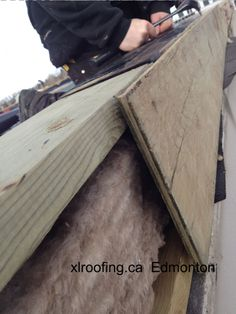 On this job roofers at XLRoofing had to build up the outside parapet with a pony wall to account for the slope package. It has been properly insulated and built with 2 x 6's and plywood.