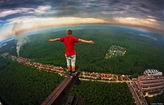 If you thought planking was a fad to be reckoned with, take a look at this new photographic trend popular amongst Russian teens. It's called skywalking, and it's when a photographer climbs his or her way up to nausea-inducing heights atop a series of structures, stands on its very edge, and snaps a photo of the view down. Skyscrapers, electrical towers, monuments -- if it's tall and dangerous looking, teens in Russia are climbing it to capture some breathtaking shots.