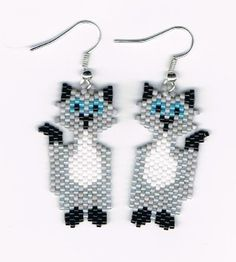 Hey, I found this really awesome Etsy listing at https://www.etsy.com/listing/129086127/hand-beaded-grey-cat-earrings