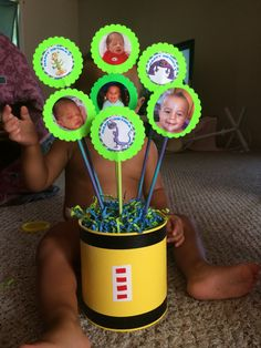 I like the idea of pics of baby with characters. Use with sand bucket!