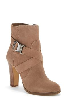This brown suede Vince Camuto boot will be a go-to this season with its contemporary belted silhouette.