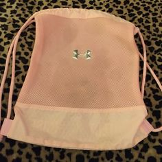 Under armed draw string bag Light pink draw string bag! There is a stain but you can't really tell at all! It may come out if washed Under Armour Bags Backpacks