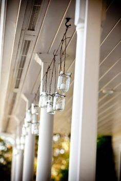 Hanging Strand of tea lights in mason jars - awesome porch lighting.