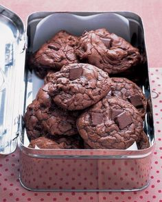 Outrageous Chocolate Cookies Recipe --  8 ounces semisweet chocolate, roughly chopped 4 tablespoons unsalted butter 2/3 cup all-purpose flour 1/2 teaspoon baking powder 1/2 teaspoon salt 2 large eggs 3/4 cup packed light-brown sugar 1 teaspoon pure vanilla extract 1 package (12 ounces) semisweet chocolate chunks