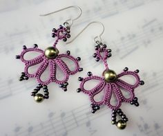 Earrings tatted in purple with light green beads
