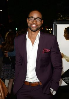 Jay Ellis and his aubergine suit, brown belt and crisp white shirt.  Styling!