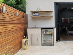 Outdoor kitchen, sink and in built drinks fridge Outdoor Laundry Rooms, Outdoor Kitchen Sink, Outdoor Sinks, Outdoor Kitchen Design, Simple Outdoor Kitchen, Kitchen Tile, Outdoor Kitchens, Drinks Fridge, Outdoor Cooking Area