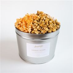Annie B's Popcorn Tin These elegant tins will bring so much joy! Popcorn flavors include Sea Salt Caramel, Sharp Cheddar, and Triple Treat. The three popular popcorn flavors are charmingly packaged and come with a divider for party-worthy presentation. $30.00