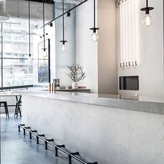 Concrete forever I'm currently fine tuning the design of the main reception of the office building I'm redesigning in Shoreditch and guess what.. My main inspiration is of course Scandinavian! The Usine Restaurant in Stockholm where @richardlindvall has performed his concrete monochrome magic is one of my must-visit places for 2016 // Love the industrial inspired 'LA LAMPE' pendant by @friendsfounders // Image via our dear friends at @simple.form // #concrete #usinerestaurant #simplicity…