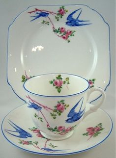 So Pretty and I love the usual shape of the plate - Shelley China Art Deco Trio Bluebird Empire (Late) c. Vintage Cups, Vintage Dishes, Antique China, Vintage China, Tea Cup Saucer, Tea Cups, China Art, Fine China, Teapots And Cups