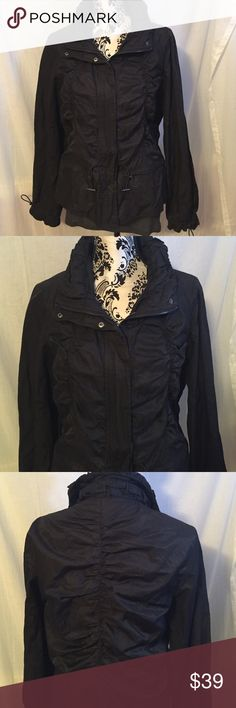 Kenneth Cole Black Windbreaker Shirred Jacket M Black windbreaker by Kenneth Cole.  Zip front with shirred design in front and back (see pics).  Very lightweight.  Great for spring and fall.  Size medium.  Has adjustable drawstrings around waist and sleeves.  Fabric:  61% cotton, 34% nylon, 5% metallic. Kenneth Cole Jackets & Coats