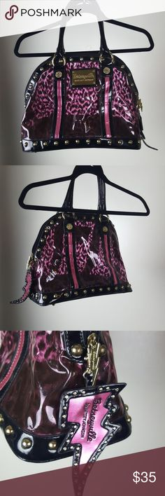 Betsyville by Betsey Johnson pink leopard jelly Large Pink leopard clear jelly pvc bag with gold studs hardware. Has some wear.  Shown in pictures. Some dimples in the jelly and some wear on some studs. Has a rip on the bottom as shown in the 6th photo of bottom of the bag.  Has key holder inside bag Comes with lightning strike super cute keychain Authentic. Betsey Johnson Bags