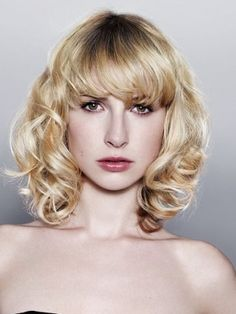 Medium Haircuts with Bangs for Face Shape and Hair Type - Choosing a mid length haircut with bangs is a lot easier to wear and style if you match it to your face shape and hair type. Get the most out of trendy hairstyles with bangs and pick one of these cute haircuts.
