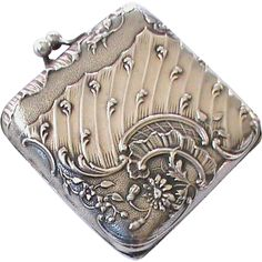 Offered for sale is this gorgeous Art Nouveau solid silver compact with a beveled mirror inside and original powder puff. It has the French silver