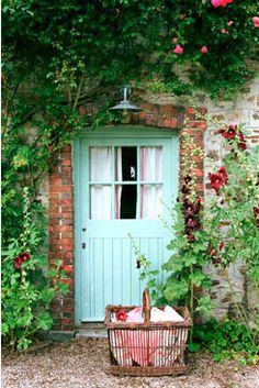 aqua door, hollyhocks, basket