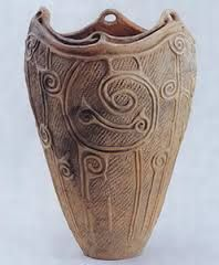 Photograph; Vessel  Circa. 11,000 to 5th Century B.C. approximately Era. Jomon Material; clay and slip Information; The main body were either press moulded or slab constructed, and the finer details attached. Jomon pottery shows the connection of the Japanese culture to their ancestors. The vessels decorations, design and adornments tell a story and showed the beliefs of the people during the ancient times.  Reference; Tokyo National Museum   COPYRIGHT ©