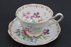 Listed is a lovely Royal Albert teacup and saucer set, the pattern is called Nosegay and is decorated with a beautiful array of colorful flowers. The set is on an Avon shape cup. Priced per cup and saucer set, I have 2 sets available. The teacup stands 2 1/2 high and 3 7/8 across the rim, the saucer has a diameter of 5 5/8. The condition is excellent with no chips, cracks or crazing. Thank you for looking, if you have any questions please feel free to contact me. Stock #1769...
